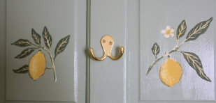 Detail of door showing two painted lemon on branch designs