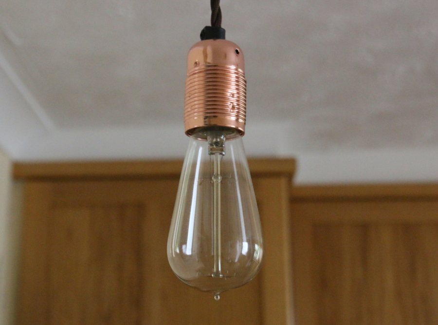 Close-up of squirrel cage bulb in copper holder