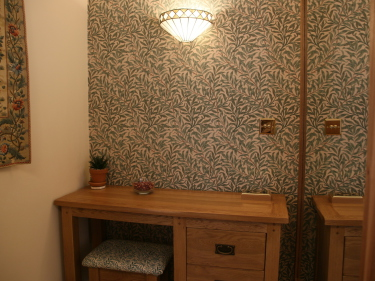 Dressing table with Tiffany wall light above